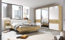 Ložnicový nábytek GEMMA_ šatní skříň s posuvnými dveřmi 3-dveřová a okrasným rámem s LED osvětlením + postelový komplet s nočními stolky a panely s LED osvětlením_ obr. 1